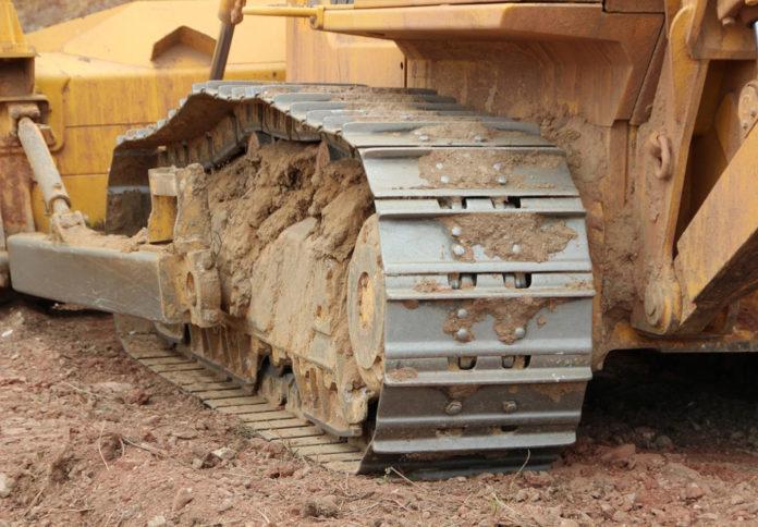 escavatore trattore dragaggio